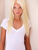 Francesca slips out of her white cotton t-shirt and panties in the soft morning light.