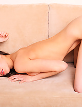 Sasha stretches out naked before you on a soft velour couch. Her auburn hair is long & flowing and her skin is soft as velvet...
