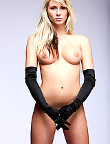 Nicole poses with picture perfect elegance wearing nothing but a pair of black satin gloves.