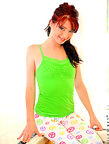 Spunky red head teasingly begins to undress