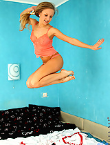 Sinovia does splits on the top of the couch in her lingerie